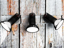 Three lamps on the wooden wall Royalty Free Stock Image