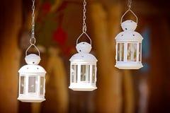 Three lanterns on a chain. Three white lanterns on a chain Stock Photography