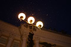 Three lanterns shine brightly in night Petersburg stock image