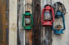 Three Lanterns on Wooden Wall Stock Image
