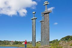 Three giant bronze swords sculpture at Hafrsfjord, Norway. Three large bronze swords celebrating Norway`s first king at Hafrsfjord, Rogaland, Norway Royalty Free Stock Image