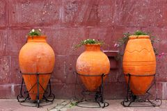 Three Large Clay Jars With Flowers On The City Street Royalty Free Stock Photos