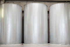 Three large clean metal cisterns for liquids Stock Images
