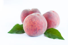 Three large fragrant peaches Royalty Free Stock Photos