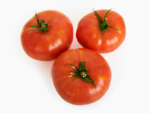 Three large fresh ripe tomato, healthy ingredient isolated on wh Stock Photos