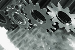 Three large gears connecting Stock Photo
