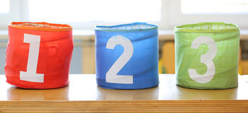 three large jars for toys with numbers one two three Royalty Free Stock Images