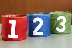 three large jars for toys with numbers one two three Royalty Free Stock Photos
