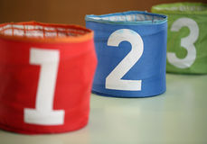 three large jars for toys with numbers one two three and the num Stock Photography