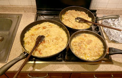 Three large pots with the typical dish called FRICO Of the Itali Stock Photography
