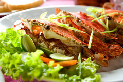 Three large red crabs with salad and lime Royalty Free Stock Images