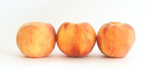 Three large ripe peaches Stock Images