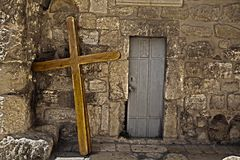 Pilgrimage Crosses. Three large scaled crusifixes resting on the wall of the Church of the Holy Sepulchre. These crusifixes are used by pilgrims who carry them Royalty Free Stock Images