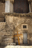 Pilgrimage Crosses. Three large scaled crusifixes resting on the wall of the Church of the Holy Sepulchre. These crusifixes are used by pilgrims who carry them Stock Photo