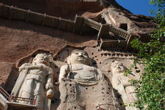 Three large statue of Buddha. The rock wall, there are three large statue of Buddha Royalty Free Stock Photography