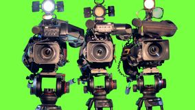 Three large video cameras on chromakey. 4K. stock video footage
