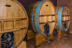 Three large wine vats with spigot. Wine celler with three large wine vats with serving spigots Royalty Free Stock Image