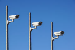 Three Laterally camera on a post in bue sky. Laterally camera on a post in bue sky royalty free stock photo
