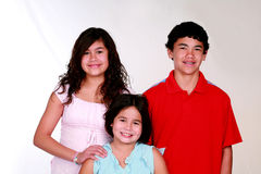 Three Latino Kids. Portrait of latino brother and sisters smiling Stock Image