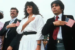 Three Latinos recite the Pledge of Allegiance at induction ceremony, East Los Angeles, California Royalty Free Stock Image