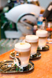 Three latte cups. Three cups of latte on the marble surface Royalty Free Stock Image