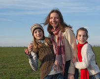 Three laughing girls. Standing outdoors Stock Photos