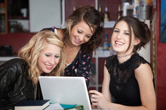 Three Laughing Girls Stock Image