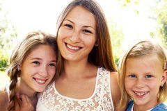 Three laughing girls. Standing on the street in the summer Royalty Free Stock Photography