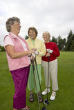 Three Laughing Golfers Stock Images