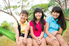 Three laughing sisters Stock Photography