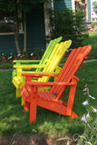 Three Lawn Chairs. Colorful lawn chairs sitting in the shade royalty free stock image