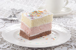 Three layer cake with coloured sprinkle Royalty Free Stock Image