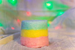 Three-layered cotton candy close-up. Three-layer colored cotton candy on a background of illuminations close-up Stock Photography