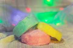 Three layers of cotton candy close-up. Three-layer colored cotton candy on a background of illuminations close-up Stock Photo