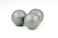 Three lead musket balls on white background Stock Photo