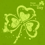 Three leaf clover grunge on green Stock Images