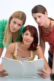 Three learning students stock photo