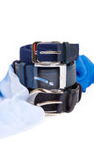 Three leather belt and a blue silk scarf  Stock Images