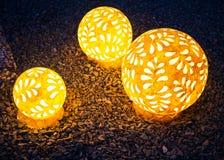Three LED balls on the gravel background, outdoor decoration. Three LED balls on the gravel background, decoration outside stock photos