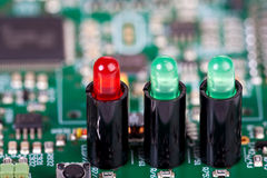 Three LEDs in sockets on a circuit board Stock Photo