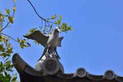 Three-legged crow on the shrine's roof, Kyoto Japan. Ornament of three-legged crow on Ima Kumano Shrine in Kyoto Japan stock image