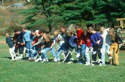 Three-legged race. In a park, Massachusetts Stock Photos