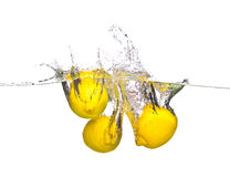 Three lemon. In dynamic water Royalty Free Stock Photos