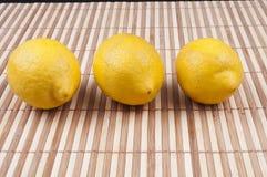 Three lemon. On bamboo background Stock Photo