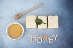 Three lemon cakes with a pot of honey and the word honey Royalty Free Stock Photo
