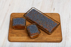 Three lemon poppy cakes on wooden plate Stock Photography