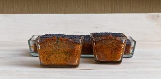 Three lemon poppy cakes on wooden plate Stock Image