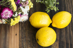 Free Three Lemons And Flowers On Rustic Wooden Background Royalty Free Stock Photo - 80096955