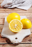 Three lemons on the board Stock Images