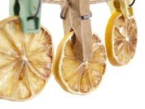 Three lemons on a clothespeg Stock Photo